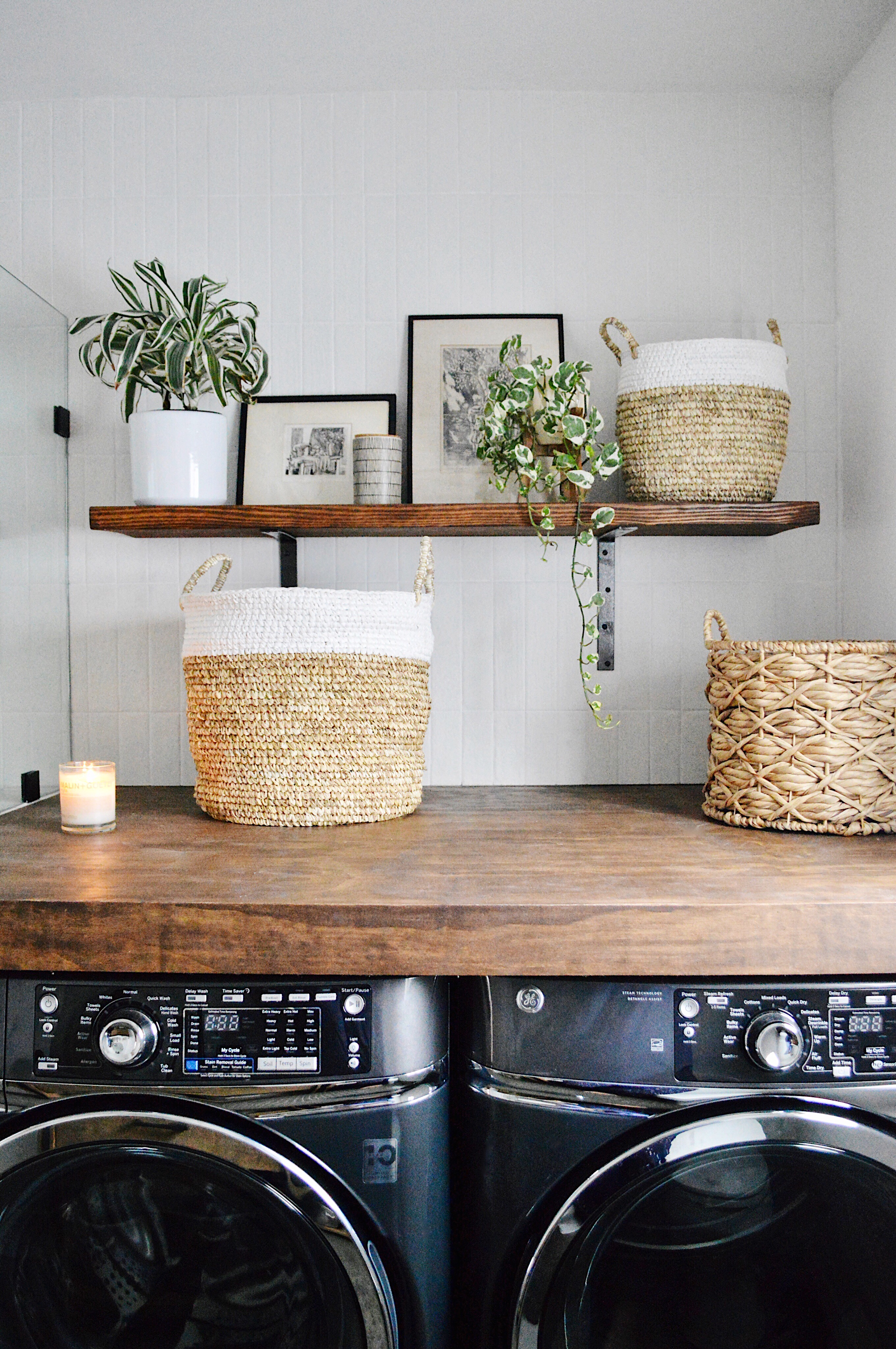 laundry space: DIY plywood and shelf, GE appliances, Bedrosians tile, AllModern baskets and thrifted art