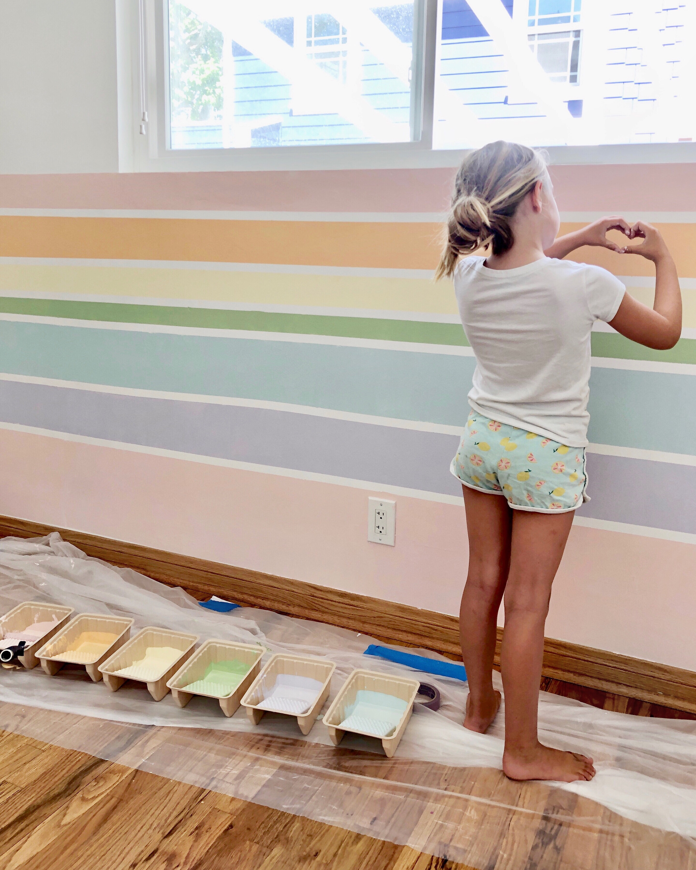 How to Paint a Rainbow Wall (and Fence!)